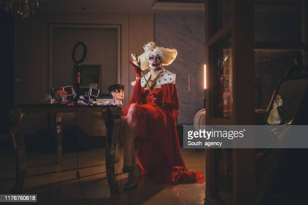 drag queen sitting in dressing room - gender fluid stock pictures, royalty-free photos & images