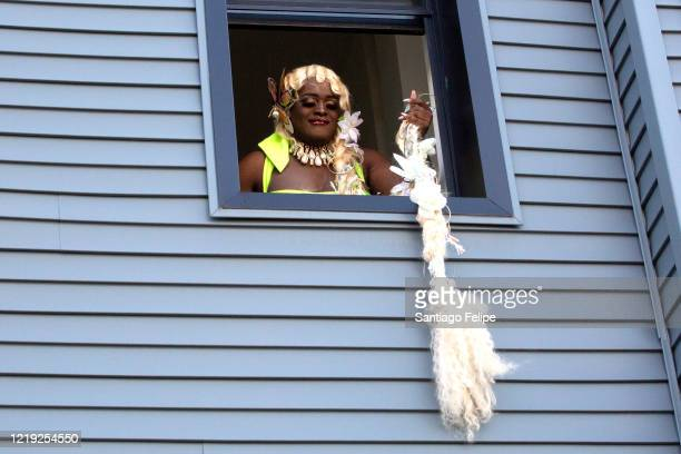 Drag queen Suburbia poses for photos out her window before hosting Susanne Bartsch's 'ONTOP' ONLINE via ZOOM on April 16 2020 in New York City