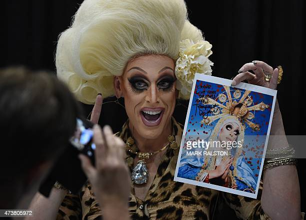 Drag Queen Temptress Les Jour poses for fans during the inaugural RuPauls DragCon at the Los Angeles Convention Center California on May 17 2015 The...