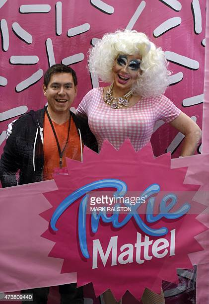 Drag Queen Trixie Mattel poses with fans during the inaugural RuPauls DragCon at the Los Angeles Convention Center California on May 17 2015 The...