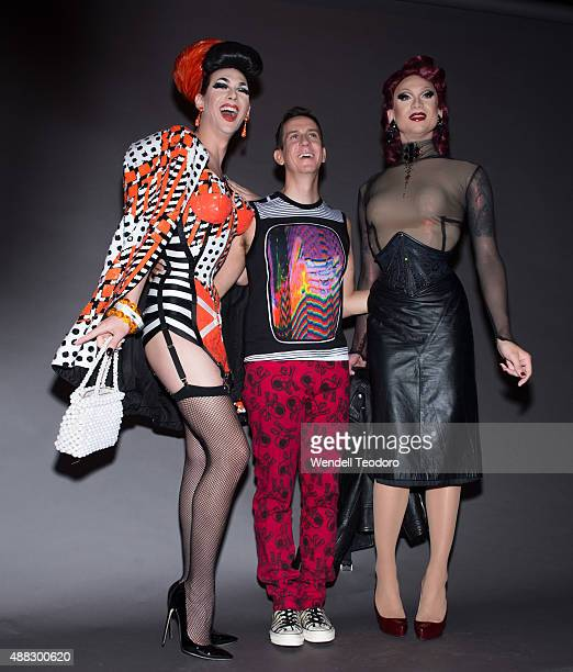 Drag Queen Violet Chachki Fashion Designer Jeremy Scott and Drag Queen Miss Fame pose backstage before the Jeremy Scott show at The Arc Skylight at...