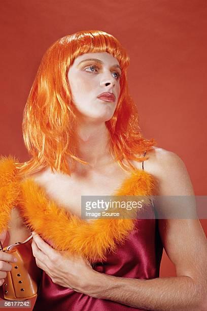 drag queen wearing an orange outfit - drag queen fotografías e imágenes de stock