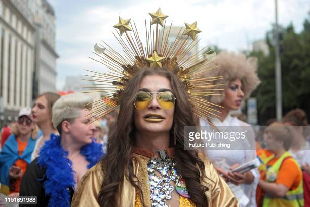 A drag queen wears a gilded crown decorated with stars during the KyivPride 2019 Equality March held in support of the LGBT community Kyiv capital of...