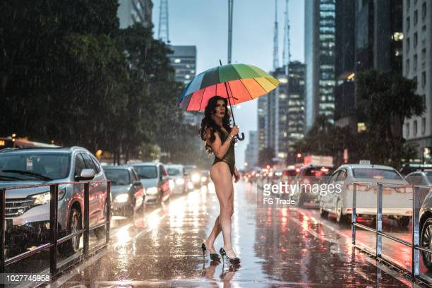 drag queen with rainbow umbrella at avenida paulista, sao paulo city, brazil - morality stock pictures, royalty-free photos & images