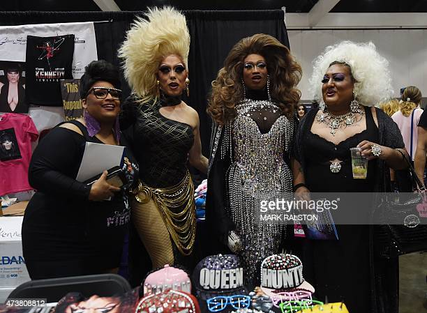 Drag Queens pose for photos during the inaugural RuPauls DragCon at the Los Angeles Convention Center California on May 17 2015 The twoday event...