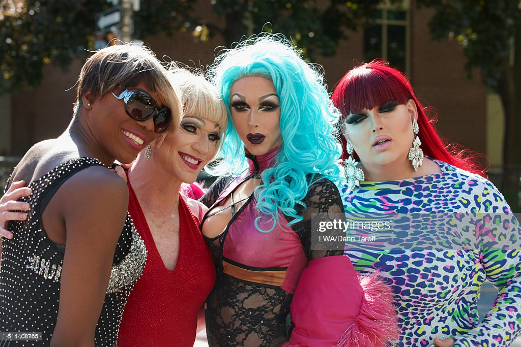 Drag queens posing on city street : Stock Photo