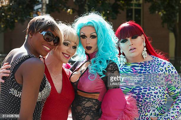 drag queens posing on city street - transvestite stock photos and pictures