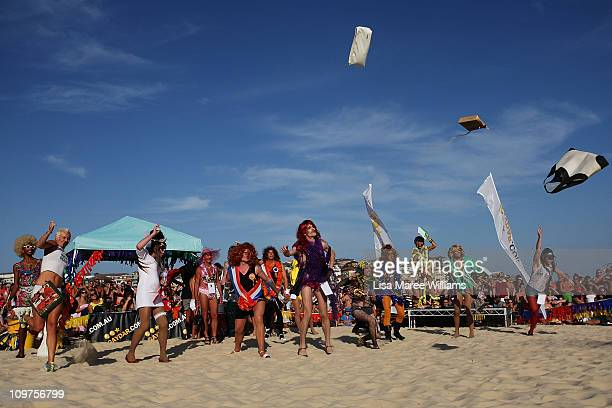 Drag Queen's throw handbags during the Sydney Mardi Gras Drag Races at Bondi Beach on March 4, 2011 in Sydney, Australia. This year's competition saw...