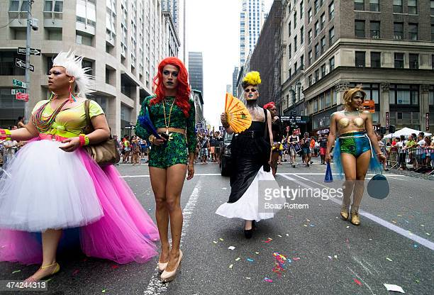 CONTENT] Drag Queens walking on 5th Ave during Gay pride in New York city USA