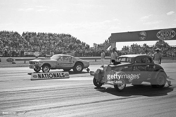 Drag racers compete in the 14th annual National Hot Rod Association Nationals held on September 2 1968 at Indianapolis Raceway Park in Clermont...