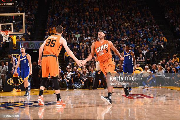 Dragan Bender and Jared Dudley of the Phoenix Suns celebrate during a game against the Golden State Warriors on November 13 2016 at ORACLE Arena in...