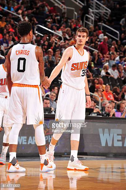 Dragan Bender and Marquese Chriss of the Phoenix Suns react during the game against the Dallas Mavericks on October 14 2016 at Talking Stick Resort...
