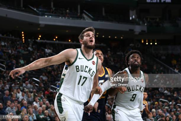 Dragan Bender of the Milwaukee Bucks and Wesley Matthews of the Milwaukee Bucks fights for position with William Howard of the Utah Jazz to grab the...