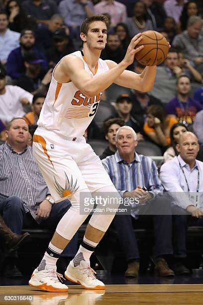 Dragan Bender of the Phoenix Suns attemtps a shot against the San Antonio Spurs during the first half of the NBA game at Talking Stick Resort Arena...