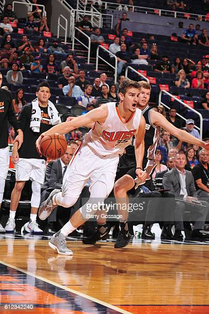 Dragan Bender of the Phoenix Suns drives to the basket against the San Antonio Spurs during a preseason game on October 3 2016 at Talking Stick...