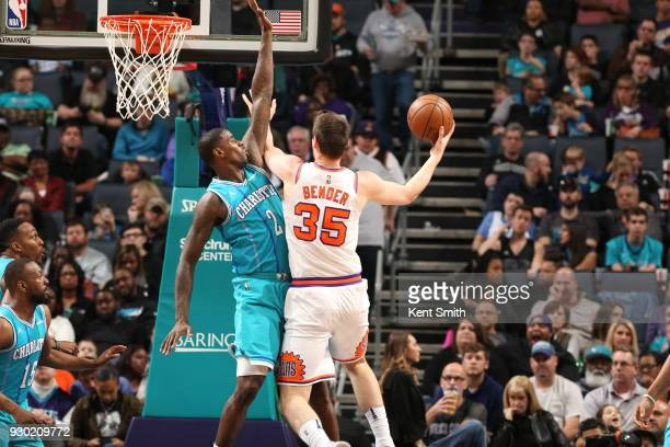 Dragan Bender of the Phoenix Suns drives to the basket during the game against the Charlotte Hornets on March 10 2018 at Spectrum Center in Charlotte...