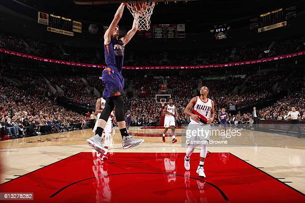 Dragan Bender of the Phoenix Suns dunks against the Portland Trail Blazers during a preseason game on October 7 2016 at the Moda Center Arena in...
