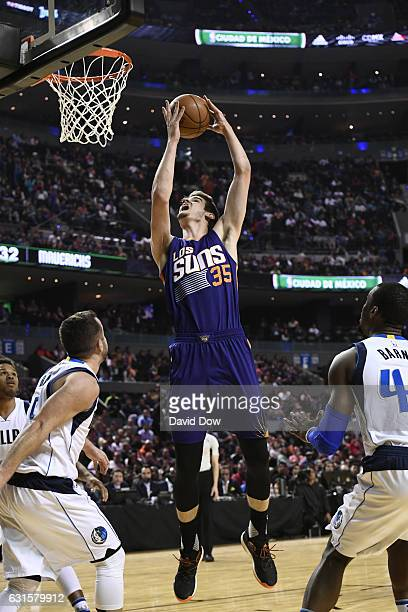 Dragan Bender of the Phoenix Suns dunks the ball against the Dallas Mavericks as part of NBA Global Games at Arena Ciudad de Mexico on January 12...
