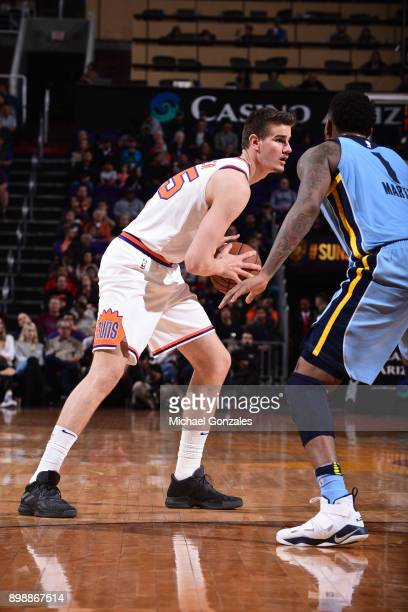 Dragan Bender of the Phoenix Suns handles the ball against the Memphis Grizzlies on December 26 2017 at Talking Stick Resort Arena in Phoenix Arizona...