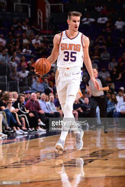 Dragan Bender of the Phoenix Suns handles the ball against the Portland Trail Blazers during the preseason game on October 11 2017 at Talking Stick...