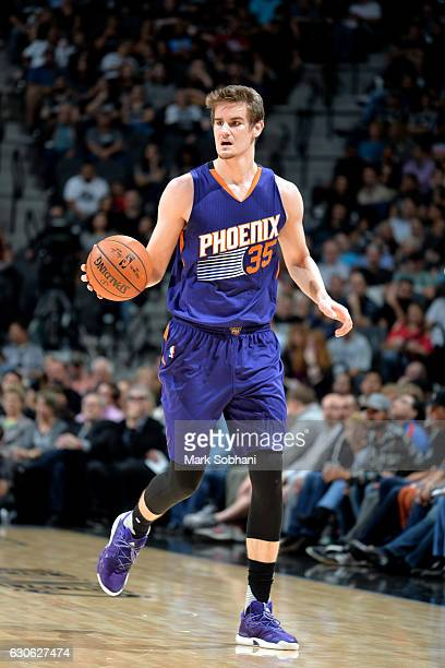 Dragan Bender of the Phoenix Suns handles the ball during the game against the San Antonio Spurs on December 28 2016 at the ATT Center in San Antonio...