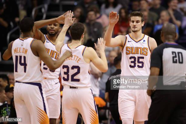 Dragan Bender of the Phoenix Suns high fives De'Anthony Melton Mikal Bridges and Jimmer Fredette after scoring against the Utah Jazz during the...