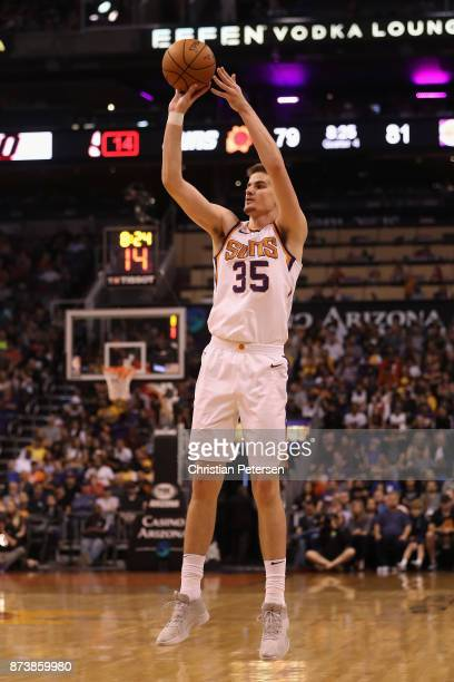 Dragan Bender of the Phoenix Suns puts up a three point shot against the Los Angeles Lakers during the second half of the NBA game at Talking Stick...
