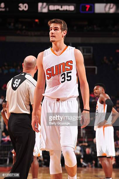 Dragan Bender of the Phoenix Suns reacts to a play against the San Antonio Spurs during a preseason game on October 3 2016 at Talking Stick Resort...