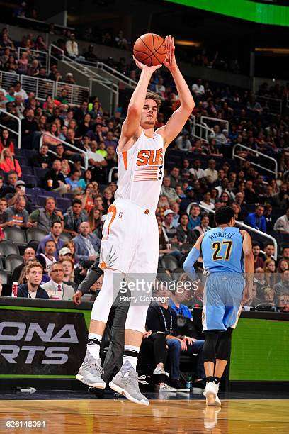 Dragan Bender of the Phoenix Suns shoots the ball against the Denver Nuggets on November 27 2016 at Talking Stick Resort Arena in Phoenix Arizona...