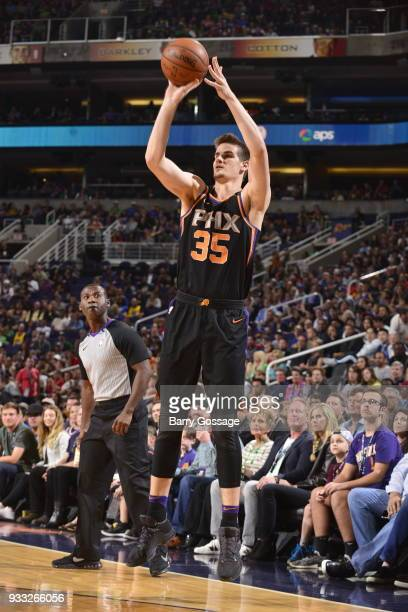 Dragan Bender of the Phoenix Suns shoots the ball against the Golden State Warriors on March 17 2018 at Talking Stick Resort Arena in Phoenix Arizona...