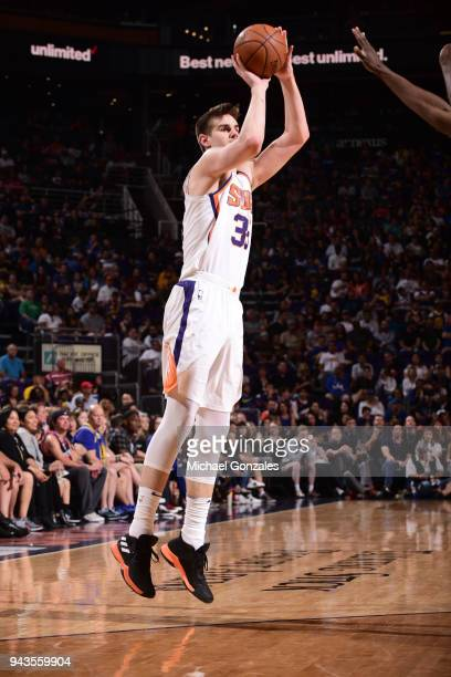 Dragan Bender of the Phoenix Suns shoots the ball against the Golden State Warriors on April 8 2018 at Talking Stick Resort Arena in Phoenix Arizona...