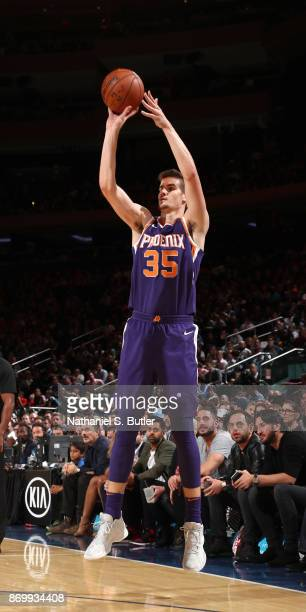 Dragan Bender of the Phoenix Suns shoots the ball against the New York Knicks on November 3 2017 at Madison Square Garden in New York City New York...