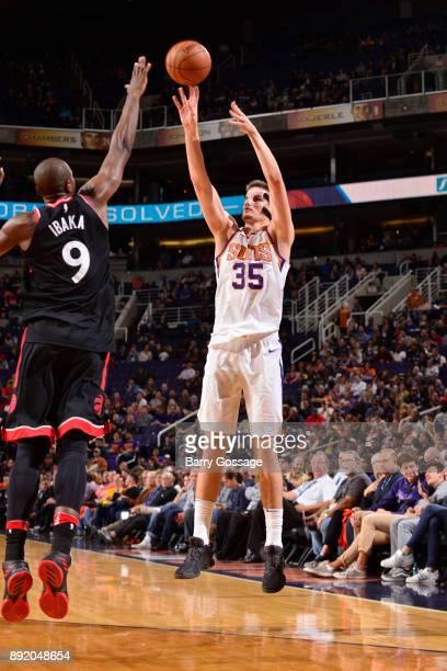 Dragan Bender of the Phoenix Suns shoots the ball against the Toronto Raptors on December 13 2017 at Talking Stick Resort Arena in Phoenix Arizona...