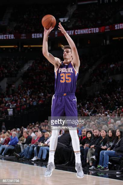 Dragan Bender of the Phoenix Suns shoots the ball against the Portland Trail Blazers on October 3 2017 at the Moda Center in Portland Oregon NOTE TO...