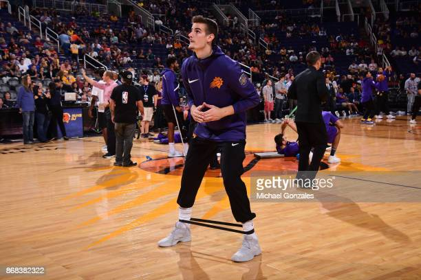 Dragan Bender of the Phoenix Suns stretches prior to the game against the Los Angeles Lakers on October 20 2017 at Talking Stick Resort Arena in...