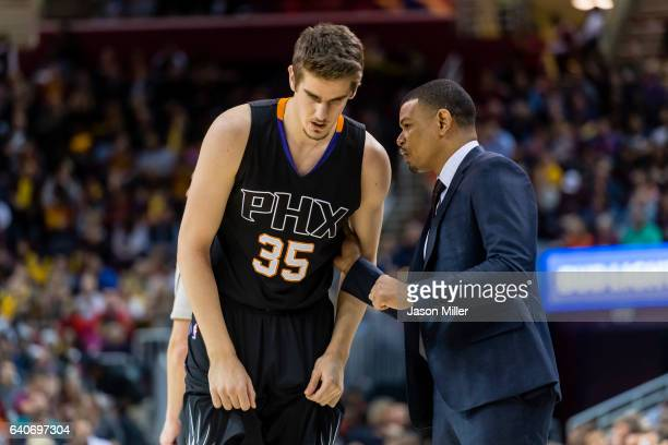 Dragan Bender of the Phoenix Suns talks to head coach Earl Watson during the second half against the Cleveland Cavaliers at Quicken Loans Arena on...