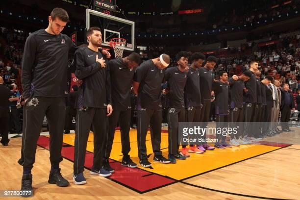 Dragan Bender of the Phoenix Suns with his teammates stand for the National Anthem before the game against the Miami Heat on March 5 2018 at American...