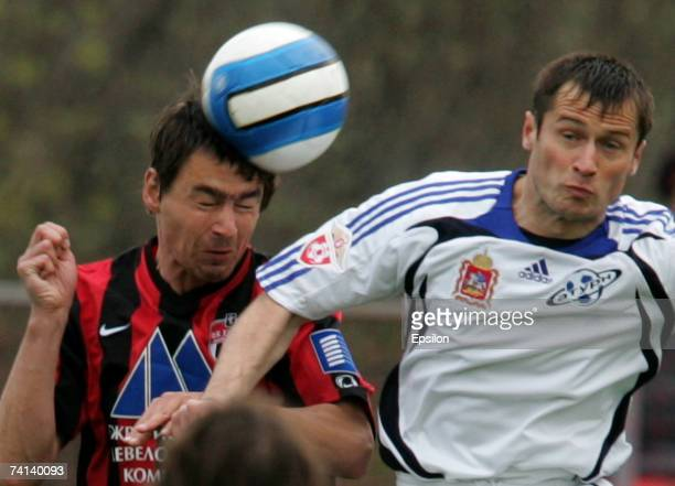 Dragan Blatnjak of FC Khimki competes for the ball with Dmitri Kirichenko of FC Saturn Ramenskoe during the Russian Football League Championship...