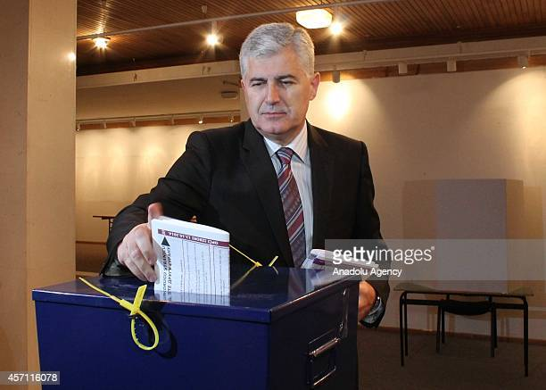 Dragan Covic leader of the Croatian Democratic Union of Bosnia and Herzegovina and contender for presidency council casts his vote at a polling...