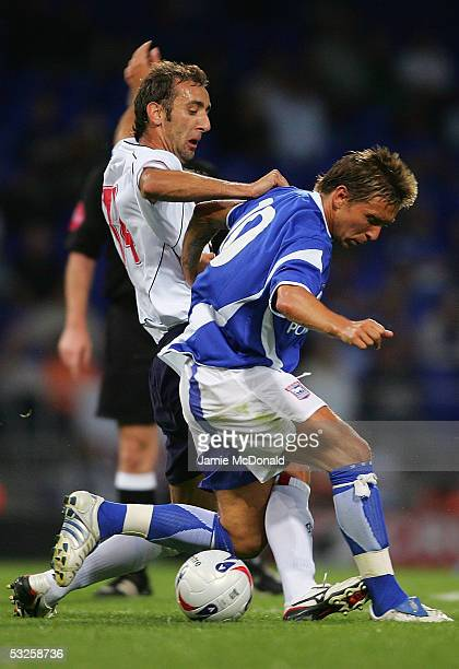 Dragan Mladenovic of Rangers tackles Darren Currie of Ipswich during the preseason match between Ipswich Town v Glasgow Rangers at Portman Road on...