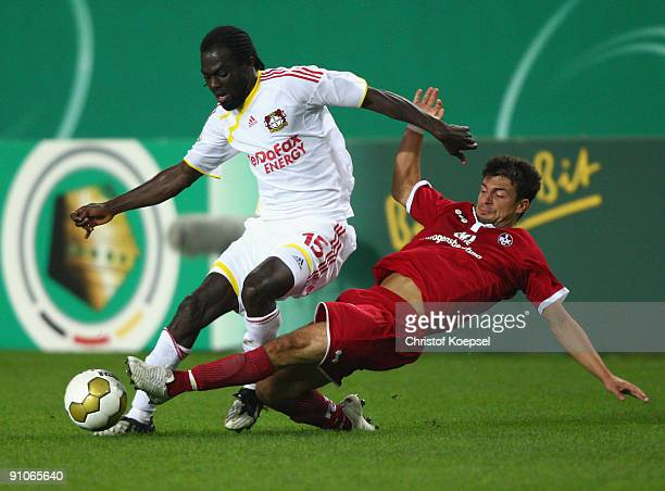 Dragan Paljic of Kaiserslautern tackles Hans Sarpei of Leverkusen during the DFB Cup second round match between 1 FC Kaiserslautern and Bayer...