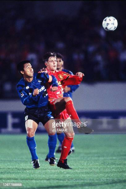 Dragan Stojkovic of Nagoya Grampus Eight and Hiromitsu Isogai of Gamba Osaka compete for the ball during the J.League Nicos Series match between...