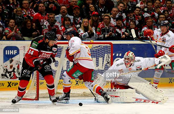Dragan Umicevic of Koelner Haie and Staphan Daschner of Duesseldorfer EG battle for the puck during the DEL Ice Hockey match between Koelner Haie and...