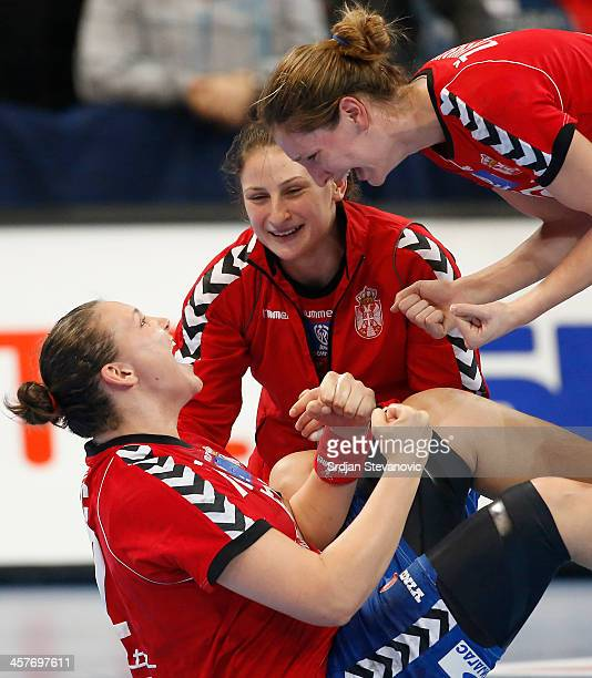 Dragana Cvijic of Serbia celebrates with teammates after victory against Norway the 2013 World Women's Handball Championship 2013 match between...