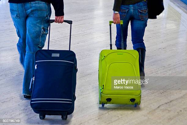 Dragging trolleys in the airport