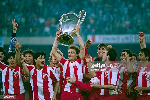 Dragisa Binic of Red Star Belgrade holds up the trophy with other members of his team at the Stadio San Nicola in Bari Italy after they won the...