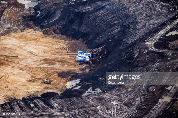 A dragline excavator is seen at the Suncor Energy Inc Fort Hills mine in this aerial photograph taken above the Athabasca oil sands near Fort...