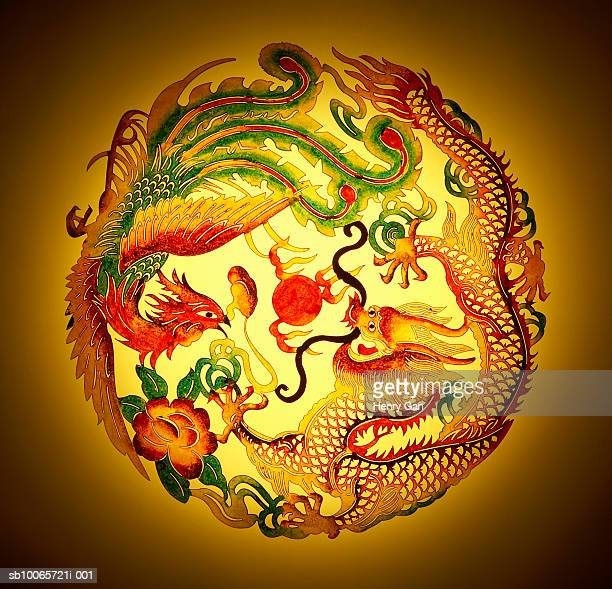 dragon and phoenix stencil on yellow background - phoenix bird stock pictures, royalty-free photos & images