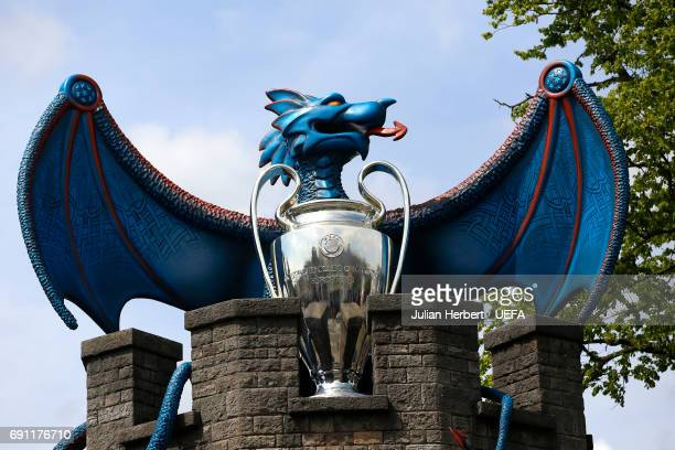A dragon and the UEFA Champions League trophy on the walls of Cardiff Castle prior to the Champions League Final between Juventus and Real Madrid on...