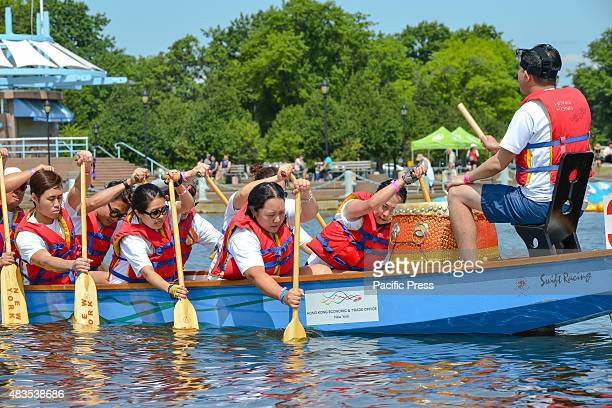 A dragon boat crew paddles as their boat's drummer marks the speed of their rowing by beating on a drumThe twoday 25th Annual Hong Kong Dragon Boat...